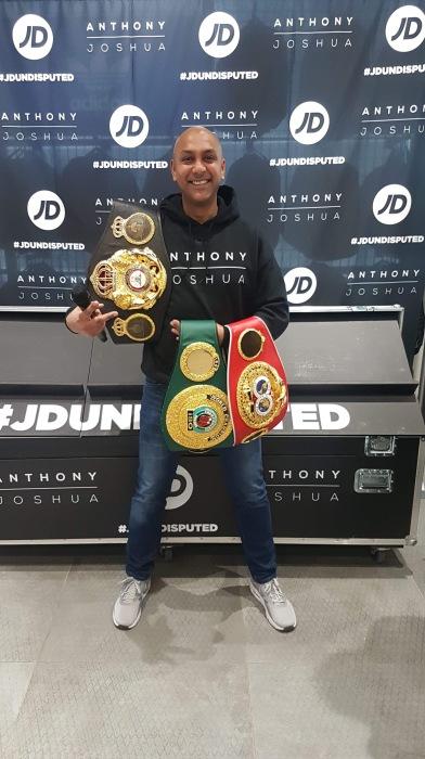 DJ Baldy with AJ's belts